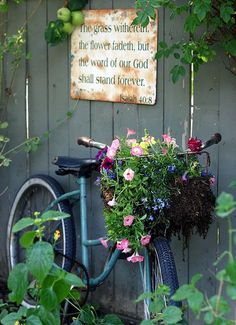 So you spray paint that old bike and fill it with flowers! My fence needs this.