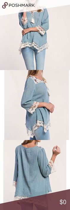 Blue Lace Trim Tunic Absolutely gorgeous dusty blue peasant tunic  top with lace and fringe tie detailing. Floral print along shoulder and neckline. Very comfortable! Bundle to save 15% from my closet. Tops Tunics
