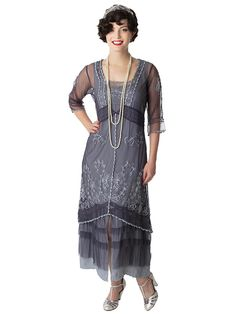 <p>Art Nouveau vintage inspired dress in deep blue embroidered fine tulle netting and lace over a silvery gray silky rayon slip liner that has rows of tulle ruffles at the hem. Lovely 1920s  elegance from Nataya's Classics collection.</p> <p>Perfect for weddings, Art Deco and Downton Abbey themed events.<br />T strap or Marjane heels are the perfect shoe style to wear with this look.</p> <p>•Pull on style, slips easily over the head.</p> <p>•Accessories not included.</p> <p>SI...