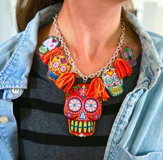 tassles between charms on a necklace.  Aunt Peaches: Sugar Skull Necklace