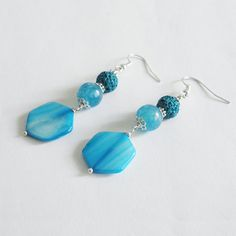Light blue earrings with angelite, mother of pearl and lava beads by La pietra blu di Avalon - SOLD