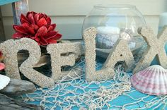 """Sand-covered letters - cut from 1/2"""" MDF to spell whatever you like, add mod podge or glue, and dip into sand, dry, then add a second coating - super beachy! - more beach crafts included in the cute vignette featured   *********************************************   Craft Goodies #beach #crafts #word #art hh"""