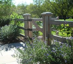 wood fence with wire panels. I like the simplicity but that it doesn't have the big open spaces of most wire fences.                                                                                                                                                                                 More
