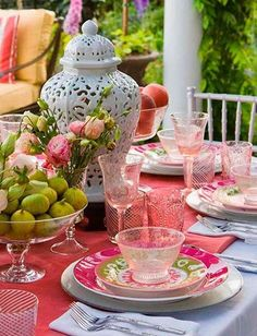 Seasonal colors and a mix of patterns makes for a playful table setting. - Traditional Home ® / Photo: John Granen