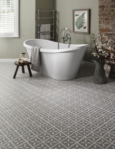 Our Dee Hardwicke Lattice vinyl tile in Pebble Grey looks great when used across a whole bathroom floor. Its subtle floral pattern brings a touch of classic style to homes whilst being super durable and maintenance-free! http://www.harveymaria.com/Floor-Range/dee-hardwicke-for-harveymaria/lattice-pebble-grey
