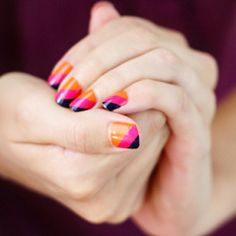 Use scotch tape to create diagonal stripe nail art in sunset shades.