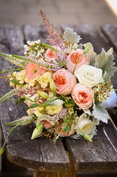 Bouquet made for a bride this past summer, peach garden roses, Veronica, ranunculus, lisianthus, stock, dusty miller, waxflower