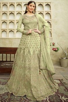 Look elegant when wearing this light green net anarkali suit which will be scene-stealing ethnic wear to shine in the spotlight. This round neck and full sleeve apparel embroidered with zari and stone work. Completed with satin churidar in light green color with light green net dupatta. Churidar is plain. Dupatta highlighted with zari and stone work. #anarkalisuit #usa #Indianwear #Indiandresses #andaazfashion Costumes Anarkali, Anarkali Gown, Anarkali Suits, Indian Salwar Kameez, Churidar, Angrakha Style, Floor Length Anarkali, Gowns Online, Traditional Looks