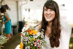 Kristi and Josh's Colourful Laid Back Wedding all under $5,000. By Jon Stars I like the wild flower bouquet