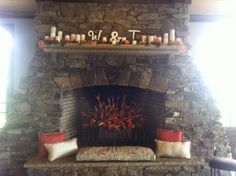 Mantle at Legacy Lookout-Fire of Flowers and candles along the top accented with pillows