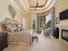 Naples Hot Properties - Coastal tranquil neutral master bedrooms - fireplace - room with a view.  Port Royal in Naples, FL