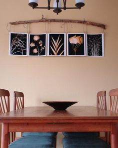 This rustic photo display adds a nice touch to the dining room. Get inspired by these floral photographs.