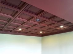 Merlot Madison Ceiling Tiles make a bold ceiling statement. Drop Ceiling idea for basement ceiling White Basement Ceiling, Suspended Ceiling Panel, Ceiling Lights, Coffered Ceiling, Burglar, Finishing Basement, Living Room Ceiling, Decorative Ceiling Tile, Dropped Ceiling