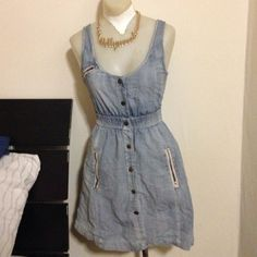 Cute Denim Vintage Dress. Cute vintage dress with buttons going down the middle.cute detail in the back of dress as well as two pockets in the front. vintage Dresses