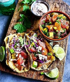 Tacos are life or you're wrong. Grilled fish tacos with citrus fruits avocado heirloom tomatoes and a garden of fresh herbs all loaded into fire roasted corn tortillas. Served alongside two handfuls of ice cold cerveza! . Courtesy: Half Baked Harvest | @halfbakedharvest . . . . . Blog: http://ift.tt/1vCV6pv  #lunch #brunch #party #fiesta #grill #grilling #bbq #barbecue #carne #churrasco #farmtotable #fresh #organic #fish #fishing #travel #tacos #mexican #spicy #foodstagram #foodgasm…