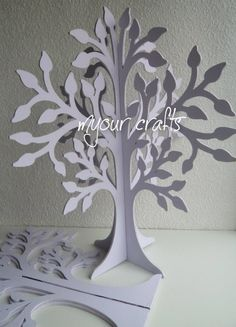 We hand decorate these free standing wooden trees for birthday,christmas,easter,christening,jewellery display