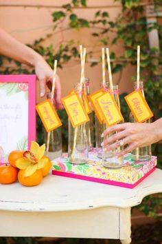 Juice bottles with escort cards- love this idea!    Fun & Colorful Lilly Pulitzer Wedding Ideas
