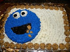 Cookie monster cake!  I did this for the boys' first birthday!  I used the Chips Ahoy mini cookies (in the snack pack) for the border and cookie crumbs.