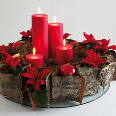 Love the RED-Red candles, Poinsettias, and Christmas ornaments make a festive holiday centerpiece