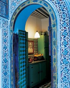 A 1940s portrait of King Hassan II hangs in the kitchen of a house in Fez, Morocco.