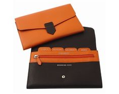 Leather document wallet - Fabriano Boutique  Leather document wallet with interior indexed slots, passport, ticket and other document compartments and zipped internal coin pocket.