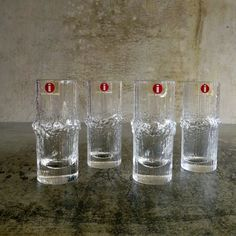 4 x Vintage Iittala  'Niva' Shot Glasses, Designed by Tapio Wirkkala. Made in Finland. each glass has the original sticker.