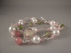 Three strands of pink, green and pearl beads make a lovely spring bracelet