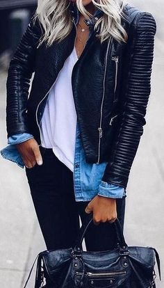 Black leather jacket over blue denim shirt, white tee and black jeans.