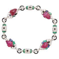 Art Deco Tutti Frutti Bracelet. Sapphire, diamond, emerald, and carved ruby bracelet, set in platinum with black enamel links. American, ca. 1930.