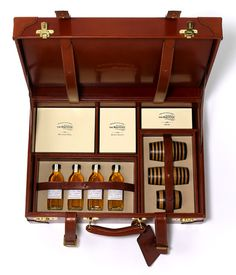 This hand-crafted leather case was made for The Balvenie Ambassador to present the Balvenie story from barley to bottle. It contains a miniature copper still, cask samples, miniature barrels and tasting bottles in bespoke boxes all beautifully finished. Luxury Packaging, Brand Packaging, Packaging Design, Label Design, Design Design, Graphic Design, Copper Still, Sample Box, Cigars And Whiskey