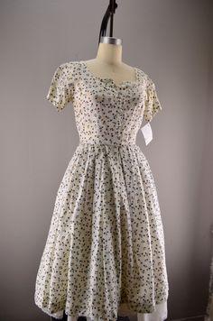 1950s floral dress Vintage day dress 50s house wife white summer flower print size medium. $48.00, via Etsy.