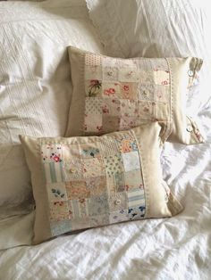She has combined linen with beautiful faded vintage fabrics. via The Hen House -- This looks like a quilt piecing project I could actually do.vintage/pastel blocks sewn into pillows. HenHouse: Spring has SprungFarm House Blessings~Old Fashion Vintage Patchwork Cushion, Quilted Pillow, Patchwork Quilting, Hand Quilting, Old Quilts, Sewing Pillows, Linens And Lace, Vintage Fabrics, Vintage Prints