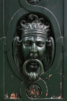 Picture of An old-style knocker in Paris on a door with weathered paint peeling. The fantastical image of the man holding the wrought iron ring in his mouth evinces the pain in the image. stock photo, images and stock photography. Door Knobs And Knockers, Knobs And Handles, Door Handles, Cool Doors, Unique Doors, Weathered Paint, Graffiti Artwork, Door Detail, Door Accessories