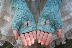*catching butterflies* | tiny owl knits - Love the idea of the butterfly in the palm of these fingerless mitts.