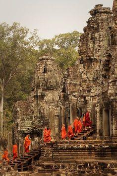 procession of buddhist monks, bayon temple, angkor, cambodia