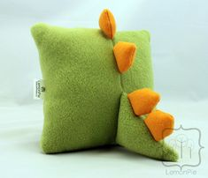 Dino Pillow, looks easy enough to make. I might have to make a couple for my boys.