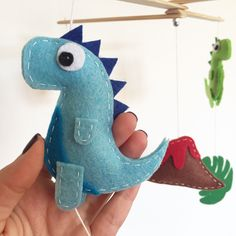 *Detail from Dinosaur baby mobile*  fully hand made with wood and felt