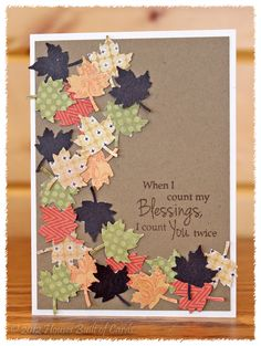 handmade card from Houses Built of Cards ... Autumn/Thanksgiving theme ... maple leaves punched from patterned papers glued on in an arc ... great use of small paper scraps ... kraft base ... fun card!
