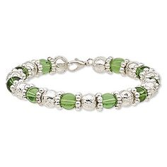 Bracelet, glass / steel memory wire / silver-coated plastic, green, 9mm wide, 8 inches with lobster claw clasp.