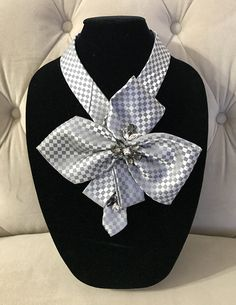 Silver and grey square pattern silk necktie necklace with a large bow adorned with clear & smoke glass rhinestones. You can wear this trendy accessory with anything and for any occasion. I refashion and adorn unique, one of a kind statement collar or necktie necklace from mens
