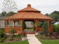 Wood Dodecagon Gazebo with Cedar Shake Pagoda Roof and Cupola http://www.backyardunlimited.com/gazebos