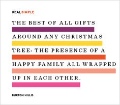 The best of all gifts around any Christmas Tree: The presence of a happy family all wrapped up in each other.