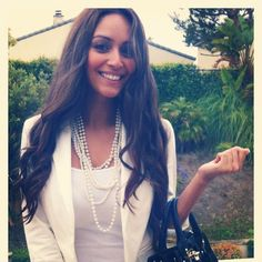 White blazer and tee with layered pearls and a contrasting bag