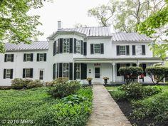 White historic home with black shutters