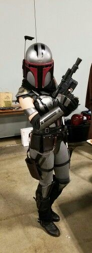 Awesome female Mandalorian cosplay.....SC Comicon - No clue what's happening with the sleeves (or lack thereof?) but the striping looks great!