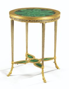 A RUSSIAN GILT-BRONZE MOUNTED STEEL AND MALACHITE GUÉRIDON BY THE TOULA IMPERIAL MANUFACTURE, CIRCA 1840