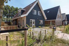 Een met hout afgewerkt huis heeft toch een andere uitstraling dan metselwerk