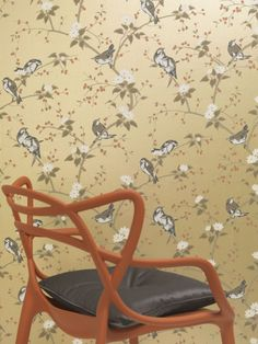 The lovely bird and tree blossom wallpaper design has a beautiful hand painted effect.