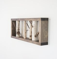 The white birch forest wall art is handmade using Maine white birch trees. Each branch is cut to size, carefully drilled and secured within the pine frame. You will receive a similar item shown in the photo. Comes with a hanger.  Size: 18 x 7.25 x 2 1/2  Shipping: USPS  - This item is made to order - Please allow 5 - 10 days to complete your order.