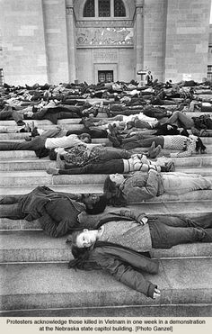 One of the defining elements of hippie was its opposition to the Vietnam War. Demonstrators here take a stand at the Nebraska Capitol in the heartland (1969?).